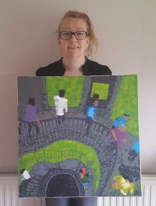 Emma with one of her paintings